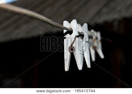 Old Wooden Clothespins For Linen On The Wire.