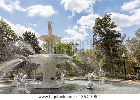 Savannah GA - March 27 2017: Forsyth Park Fountain dates to 1858 and is symbolic of Savannah. It is a popular tourist destination within the city's historic district.