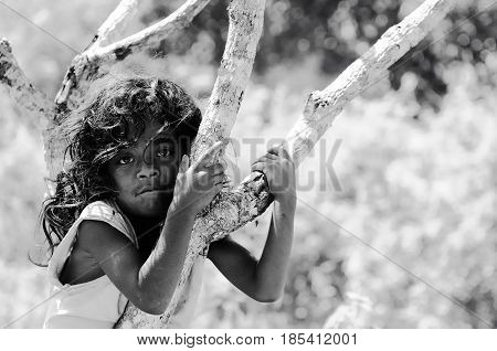 SOE TIMOR INDONESIA - APRIL 25: Unidentified ethnic Indonesian child on an island Timor in the village of headhunters on an Timor island in Indonesia. Soe on April 25 2011