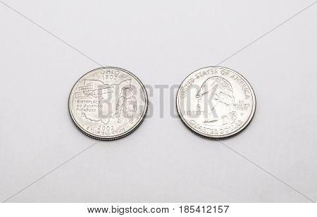 Closeup To Ohio State Symbol On Quarter Dollar Coin On White Background