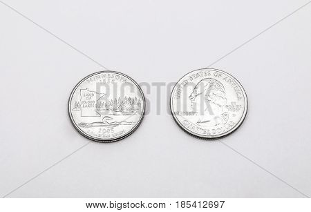 Closeup To Minnesota State Symbol On Quarter Dollar Coin On White Background