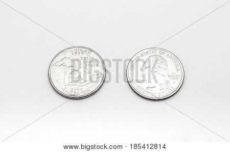 Closeup To Michigan State Symbol On Quarter Dollar Coin On White Background