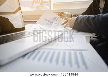 Business adviser analyzing financial figures denoting the progress in the work of the company business team concept.
