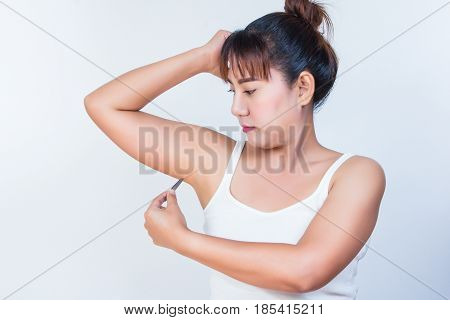 woman using tweezers and she plucking hairy armpits