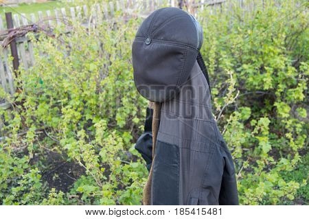Men's Work Clothes Hanging In The Garden Coat And Hat