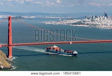 SAN FRANCISCO - APRIL 19: MOL container ship enters San Francisco Bay under Golden Gate Bridge on April 19, 2017. The MOL Guardian is 275m long.