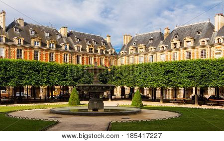 Place des Vosges (Place Royale) major landmark in Paris located in Marais district.