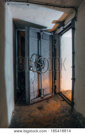 Opened hermetic door of an abandoned Soviet bomb shelter, an echo of the Cold War, Voronezh, Russia