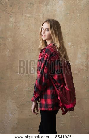 Beautiful Girl With Backpack In Stylish Red Checkered Shirt