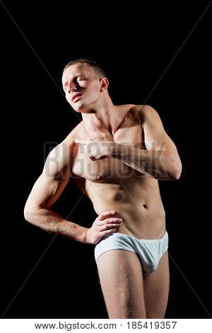 muscular man show hand on shoulder or bare torso in white pants on black background guy has shoulder pain concept with healthcare and medicine
