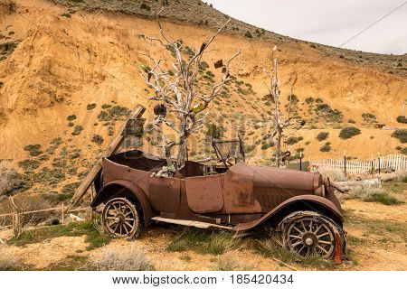 Remains of old car by quarry at entrance to the old town of Virginia City in Nevada, a center for gold and silver mining in the past
