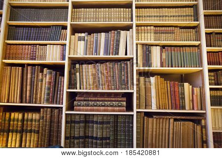 January 25, 2017 Leeds Castle, England: Typical interior of an English castle. Library room in Leeds Castle with bookshelves full of books.