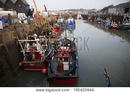 Whitstable, Kent, United Kingdom - February 24, 2017: Small harbour of Whitstable with fishing boats