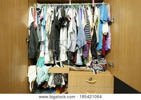 many clothes in the closet wardrobe in the house.