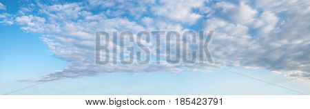 Turquoise Sky With Fleecy Clouds