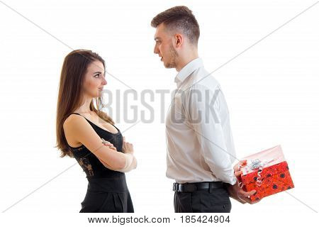 a young guy in a white shirt brought beautiful girl behind gift isolated on white background