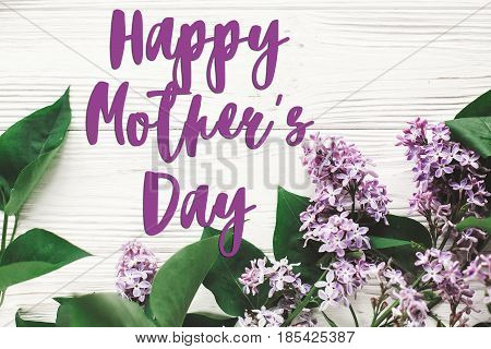 Happy Mother's Day Text Sign. Greeting Card. Gentle Pink Lilac Flowers On White Rustic Wooden Backgr