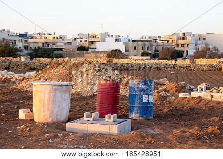 Construction material and activities in a field on the outskirts of Attard and Mosta Malta.