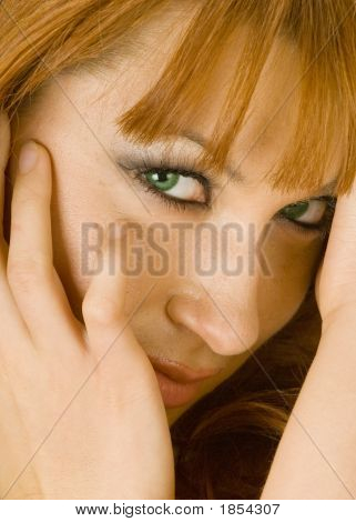 Beautiful Redheaded Woman With A Shy Smile