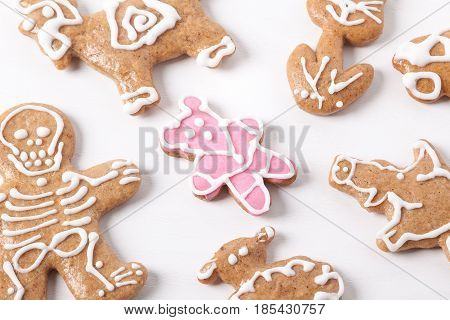 Christmas gingerbread cookies and a lone pink teddy bear, Unconventional cookies, Hand decorated with colorful Christmas cookies on white plate, Gingerbread pastry, Christmas cookies