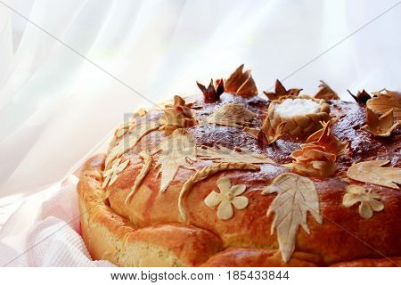 beautiful round loaf with floral patern of flowers and leaves