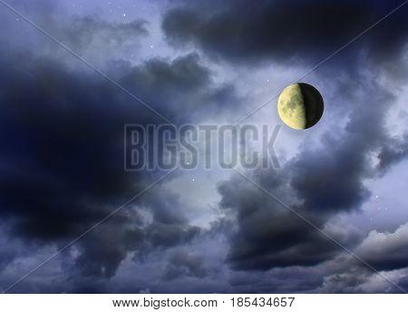 Moon glowing in the dark cloudy sky. Moon in starlit night