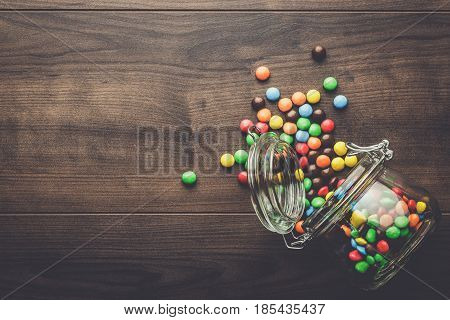 topple over glass jar full of colorful sweets