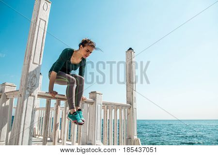 sporty girl on the pier doing exercises to do fitness , sports motivation, sports, healthy lifestyle