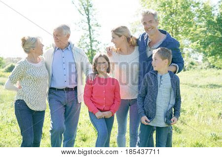 Intergenerational family walking together in park