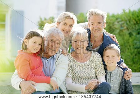 Portrait of intergenerational family sitting on bench