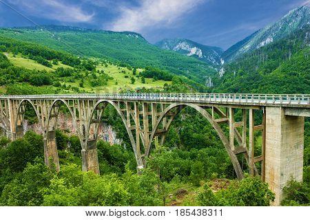 Mountain landscape Montenegro. Durdevica Tara arc bridge in the mountains One of the highest automobile bridges in Europe.