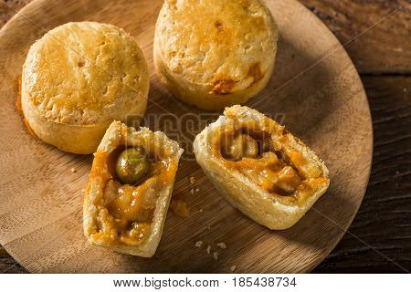 Empada Brazilian Snack. Pie With Shrimp On Wood Plate On Wooden Background