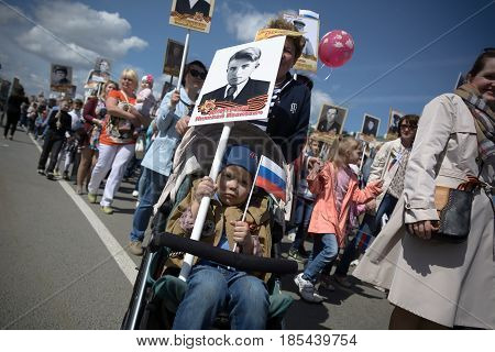 Yoshkar-Ola, Russia - May 9, 2016 Photo of a small boy participating in an annual action of memory called the immortal regiment, timed to the day of victory in the Great Patriotic War of 1941-1945