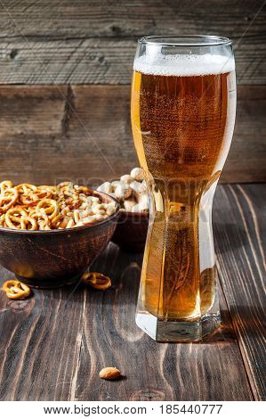 Glass Of Beer And Snacks. Good Combination Of Malted Drink With Crackers And Nuts