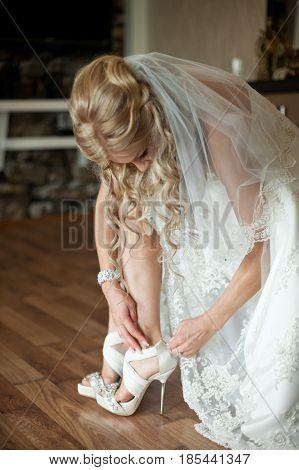 Blonde Bride Adjusts The Open Toe Wedding Shoes