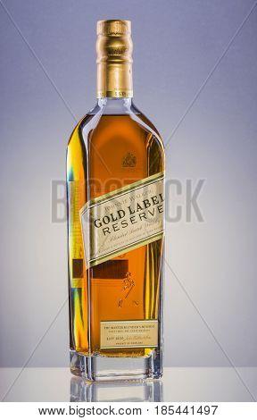 Johnnie Walker Gold Label blended whisky on gradient background. Johnnie Walker was established in 1820 in Kilmarnock, Scotland.