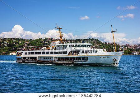 Istanbul, Turkey - May 6, 2017: Tourist vessel in Bosporus, Istanbul, Turkey
