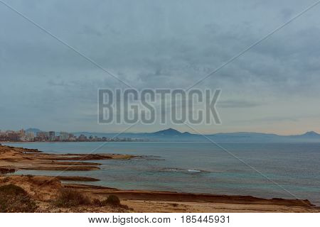 Coastline of a Sant Joan city at early morning. Costa Blanca Alicante province. Spain