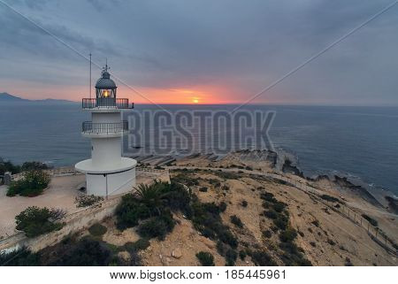 Lighthouse on a hilltop at sunrise. Alicante Costa Blanca. Spain