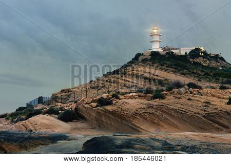 Lighthouse on a hilltop at early morning. Alicante Costa Blanca. Spain