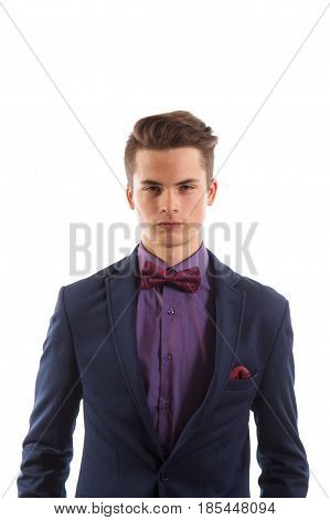 A young man wearing a suit with a purple shirt