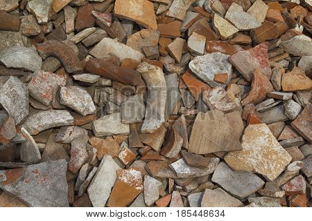 Background: heap of antique ceramic shards excavations