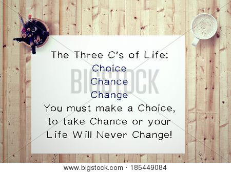 Inspiring motivation quote handwritten on a notepad the three c's of life: you must make a choice, to take a chance ot your life will never change. White pad paper image.