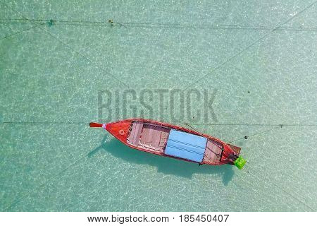 Aerial view over long tail boat with beautiful sea and beachTop view from drone Koh Lipe island SatunThailand.