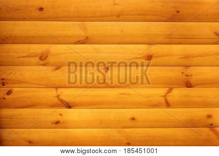 Orange wooden slats with knots joined together. Wooden texture background