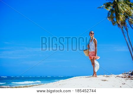 Happy girl on the tropical white beach