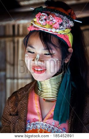 Thailand North Chiang Rai - January 2016: a girl of the Padaung tribe smiling in a traditional national village.