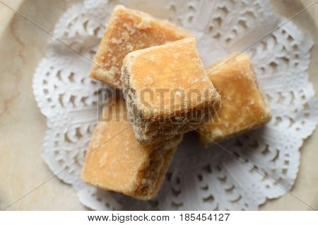 Fudge Cubes Arranged On Doily Overhead Close Up