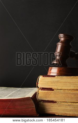 Old Books Stacked And Topped With Wooden Gavel - Chalkboard Background