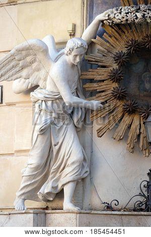 ROME, ITALY - SEPTEMBER 03: Angel, Madonna dell'Archetto, Shrine by Virgìlio Vespignani, Palazzo Castellani, Piazza di Trevi in Rome, Italy on September 03,2016.